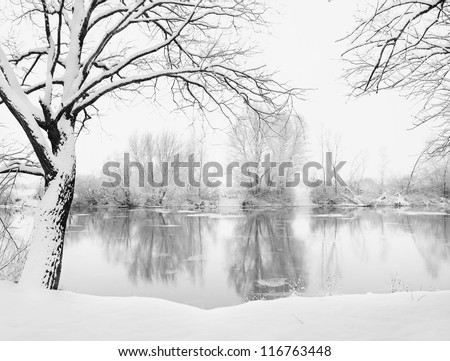 Winter landscape of frosted river - stock photo