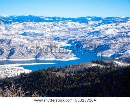 winter landscape of snow, mountains and lake