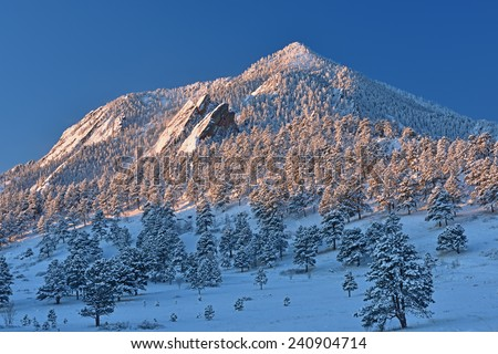 Winter landscape of the Flatirons on Bear Peak at sunrise, Rocky Mountains, Boulder, Colorado, USA - stock photo