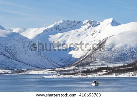Winter landscape of the Norwegain sea near Tromso North of Norway