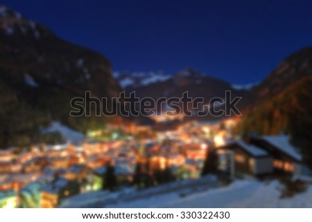 Winter landscape of village in the mountains - stock photo