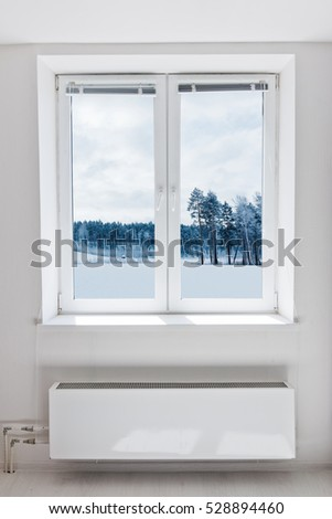 Winter landscape seen through the window.