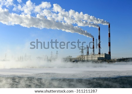 winter landscape smoke from the chimneys Zainsk TPP against the blue sky frosty misty morning