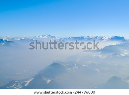 Winter landscape, snow on high mountains with blue sky background - stock photo
