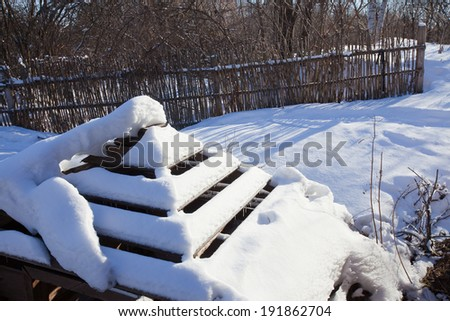 winter landscape trough for animals and birds in a pine forest bright sunny day - stock photo