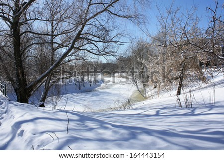 Winter landscape. View of the frozen river.