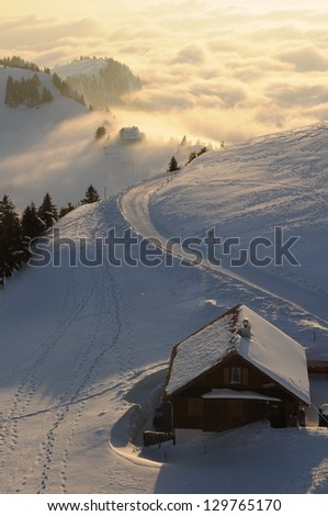 Winter landscape with a house on the mountain Rigi, in Switzerland - stock photo