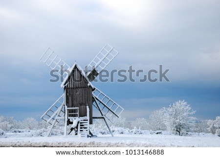 Winter landscape with an old wooden windmill at the swedish island Oland - the island of sun and wind