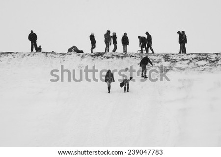 Winter landscape with fields and people enjoying the snow