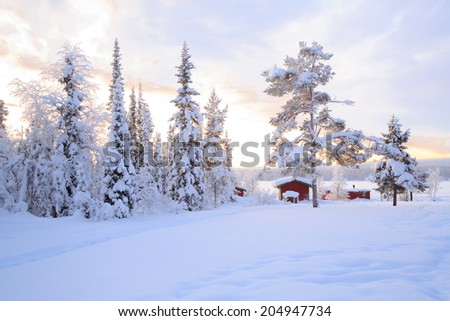 Winter landscape with house at Kiruna Sweden lapland - stock photo