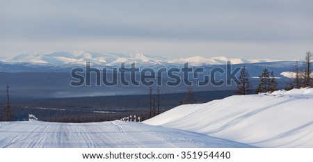 Winter landscape with road and mountains Stanovoi range in South Yakutia, Russia - stock photo