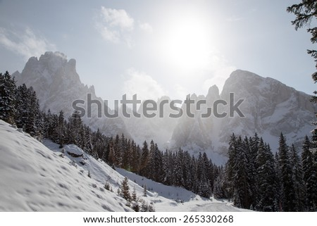 Winter landscape with road /  Winter landscape on Monte Pana, South Tyrol, Italy. - stock photo