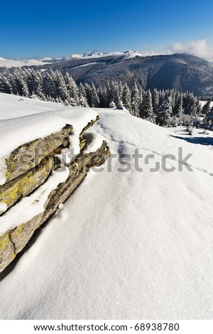 winter landscape with rocky mountain