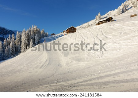 Winter landscape with ski huts - stock photo