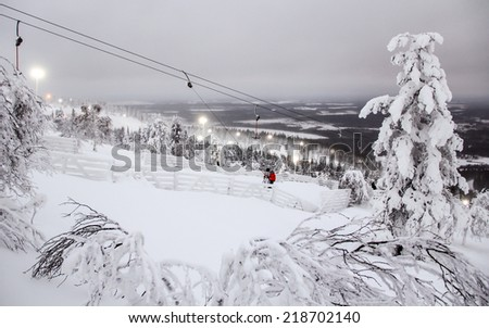 Winter landscape with ski lift in Levi resort in Lapland, Finland, at polar night - stock photo