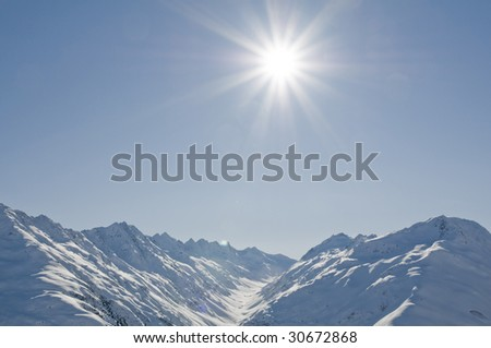winter landscape with sun - stock photo
