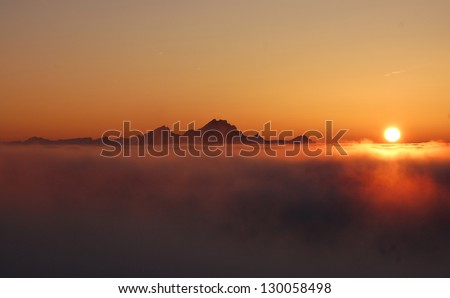 Winter landscape with sunset above the clouds, on the mountain Rigi, Switzerland - stock photo