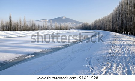 Winter landscape with the frozen river
