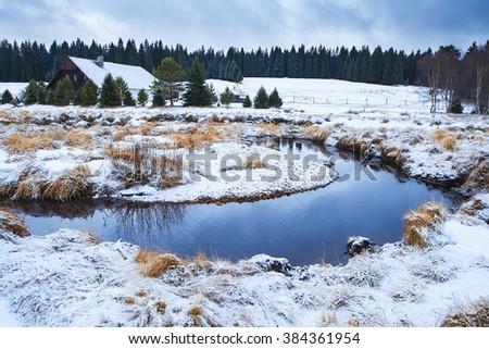 Winter landscapeof solitude farm near forest - stock photo