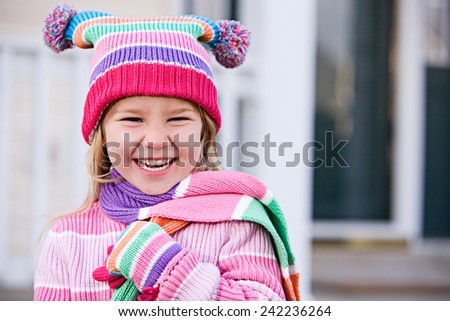 Winter: Laughing Girl Outside In Cute Clothing Waiting For Snow - stock photo