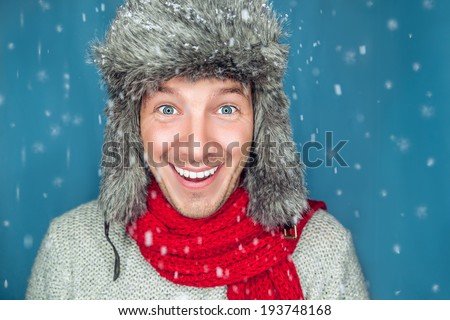winter man looking snow flakes - stock photo