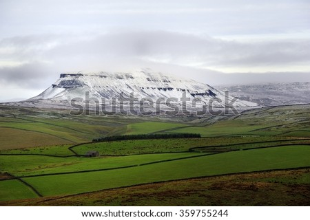 Winter mist covering the summit of Pen-y-ghent - stock photo