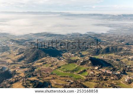 Winter misty landscape early in the morning  in La Garrotxa, Catalonia - stock photo