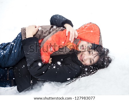 Winter. Mother and child playing in snow