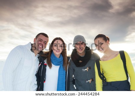 Winter mountain and people silhouette at snow - stock photo