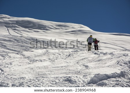 Winter mountain climbers in the Alps. Outdoor shot using natural light in the french Alps.