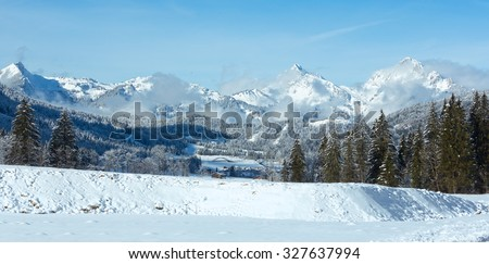 Winter mountain country landscape with fir trees (Heiterwang outskirts, Austria, Tirol)