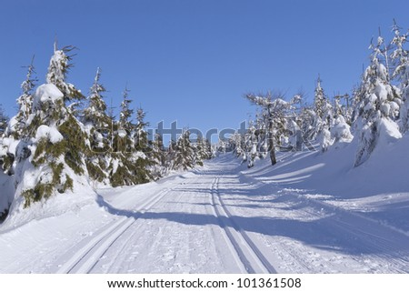 Winter mountain landscape with cross country skiing way. (Mountains Jeseniky, Czech Republic) - stock photo