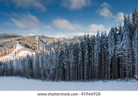 winter mountain landscape with ski lift and skiing slope - stock photo