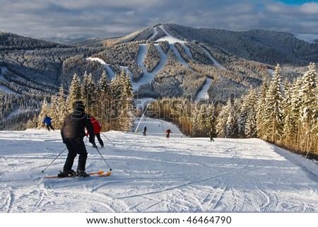 winter mountain landscape with skiing slope - stock photo