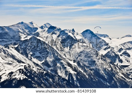 Winter mountains and paragliding