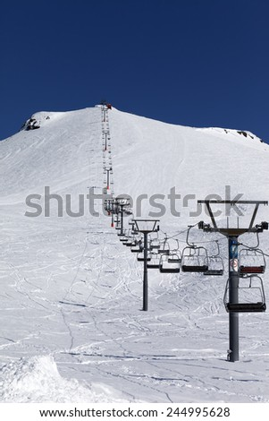 Winter mountains and ski slope at nice day. Caucasus Mountains, Georgia. Ski resort Gudauri. - stock photo
