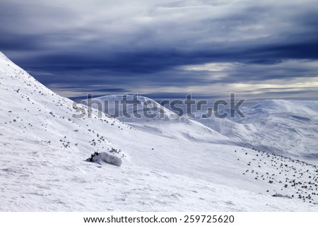 Winter mountains and storm sky. Ukraine, Carpathian Mountains. - stock photo
