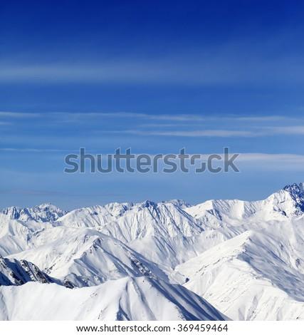 Winter mountains in nice day. Caucasus Mountains, Georgia, region Gudauri. View from ski slope. - stock photo
