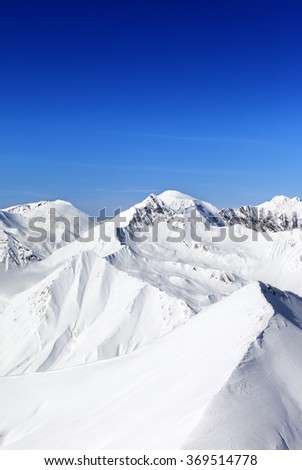 Winter mountains in nice sun day. Caucasus Mountains, Georgia, region Gudauri. View from ski slope. - stock photo