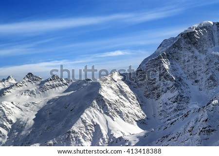 Winter mountains in snow at sun evening. View from slope mt. Elbrus, Caucasus Mountains.