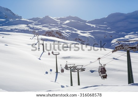 Winter mountains panorama with ski slopes and ski lifts  - stock photo