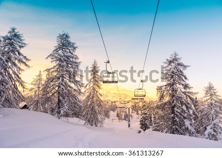 Winter mountains panorama with ski slopes and ski lifts near Vogel ski center, Slovenia