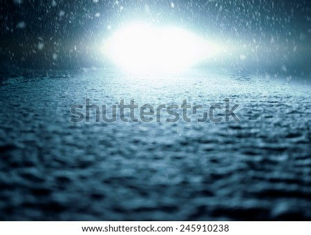 Winter Night Driving - Winter Road - Abstract winter background - Snow covered road at night. - stock photo