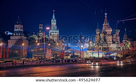Winter night landscape in the center of Moscow. Kremlin towers, St. Basil's Cathedral on Red Square
