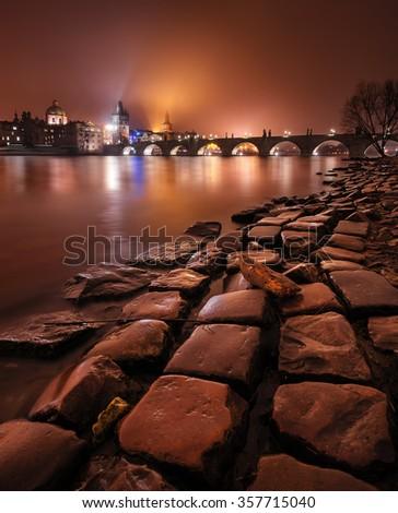 Winter night near Charles Bridge in Prague, Czech republic - stock photo