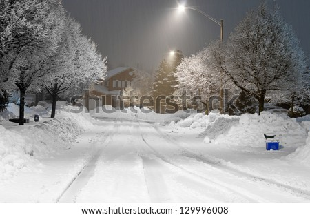 Winter night scene in the suburbs - stock photo