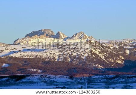 Winter on Mount Moran in the Teton Mountain range as seen from the Idaho side in the Teton Valley. - stock photo