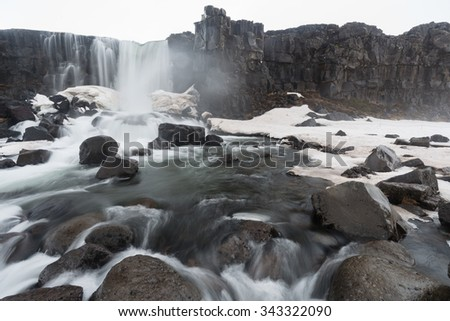 Winter Oxararfoss: waterfall in Thingvellir National Park, Iceland - stock photo