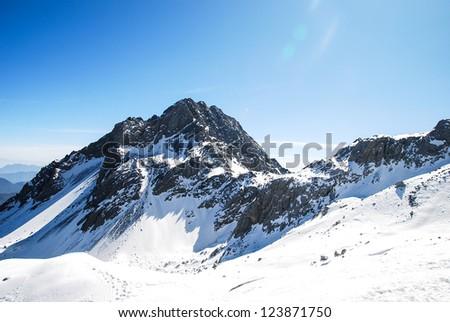 Winter Panorama of Jade Dragon Snow Mountain - stock photo