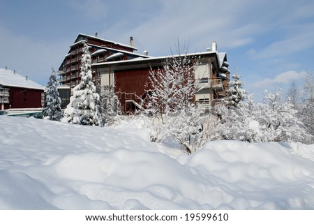 Winter paradise with fresh snow and wood cottage